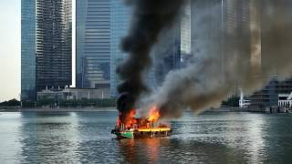 Boat on fire in Marina Bay