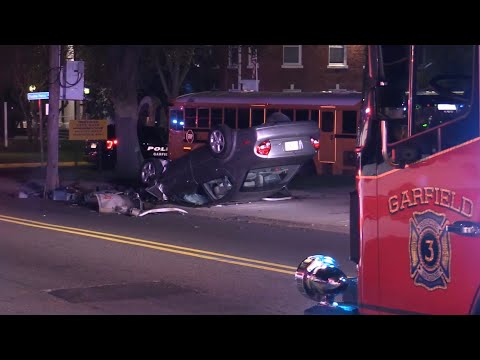 VIDEO: Rollover Driver Who Hit Sign, Broke Pole Outside Garfield HS Was On Phone, Police Charge