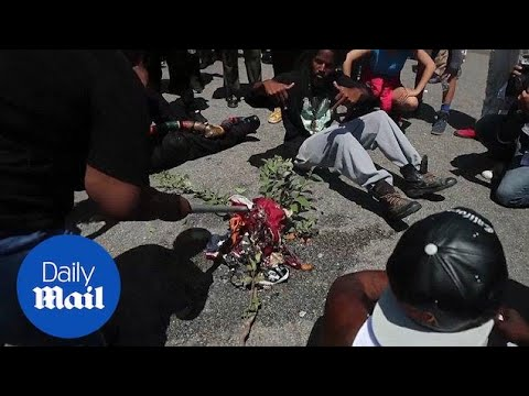 Counter Protesters Burn An American Flag At Maxine Waters Office