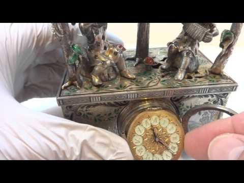 Winding the clock (antique gnome singing bird box)