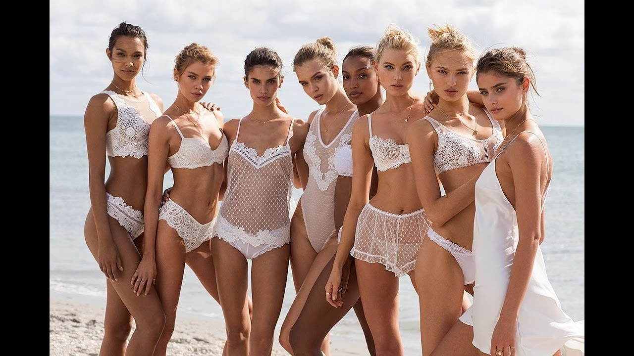 Treasure Rich:  Is A White Victoria Secret Model (I see she is too busy kissing for WS...)