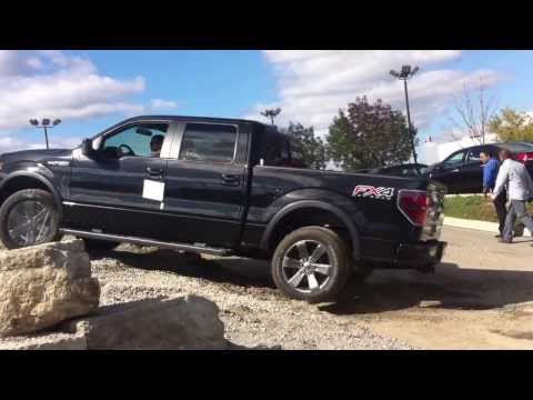 Ford F150 going on a tiny dirt road at East-Court Ford Lincoln