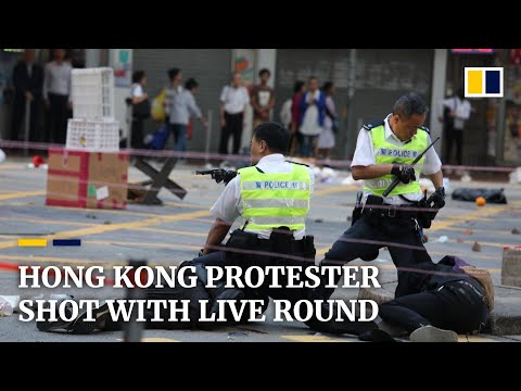 Hong Kong protester shot with live round as unrest in city enters sixth month