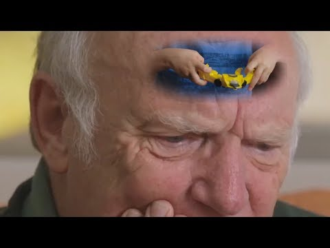 Old Man watches children play with Transformers