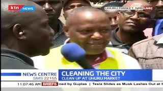 President Uhuru Kenyatta joins clean up exercise at Uhuru market