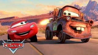 Mater Races in the Radiator Springs Grand Prix! | Pixar Cars