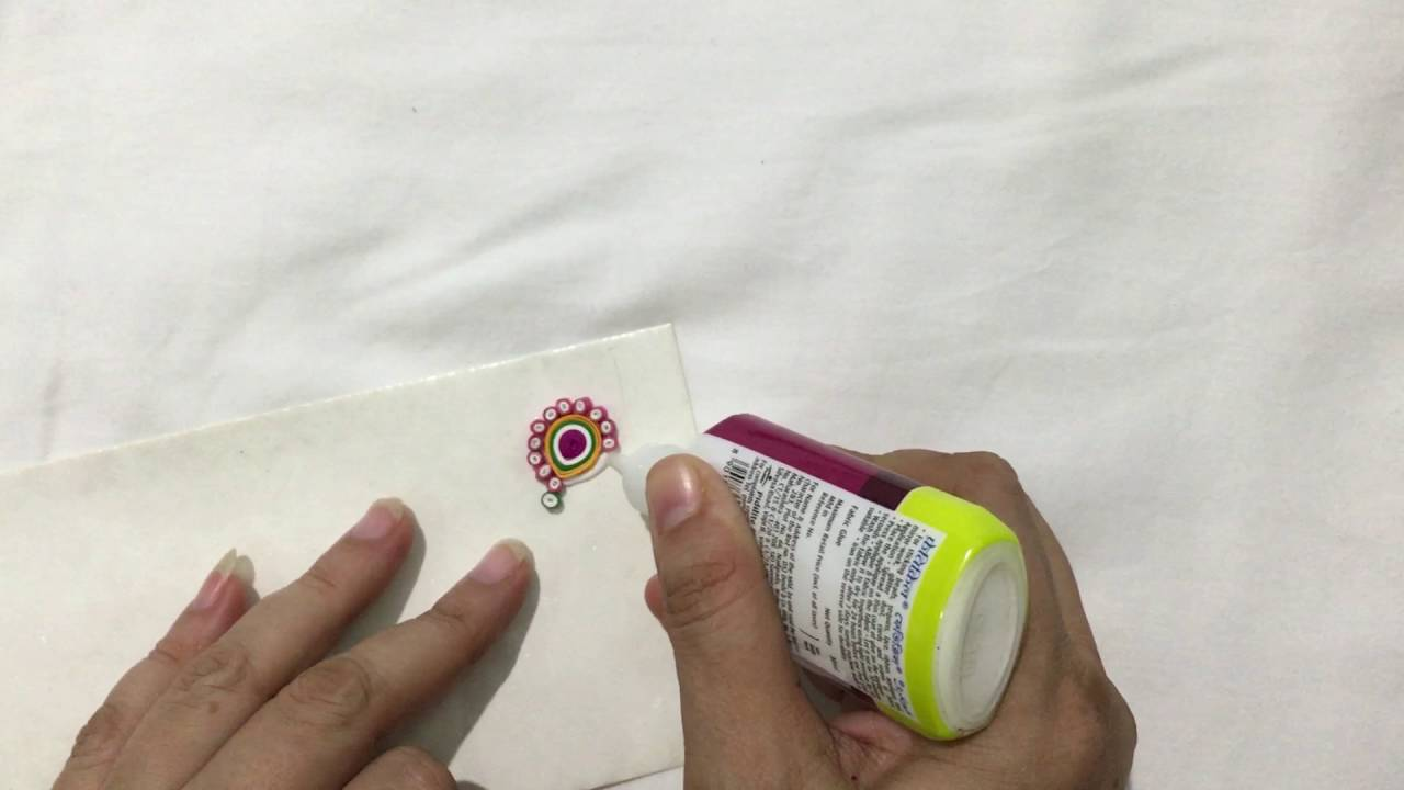 Papercraft Vrinda's Creations - ornamental quilling on an envelope