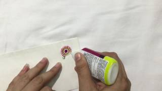 How to make ornamental quilling on an envelope by Vrinda Deshmukh