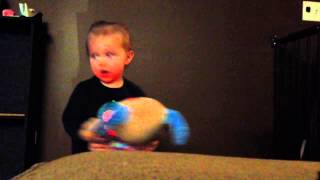 15 month old baby plays with dog toy