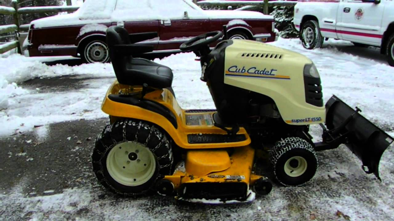 how to plow your driveway with a lawn tractor with a snow