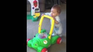 Liam pushes mower