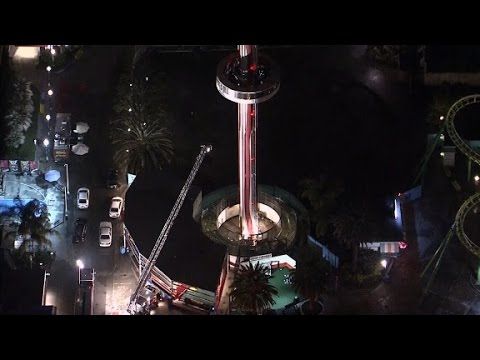 21 trapped 100 feet in the air on theme park ride