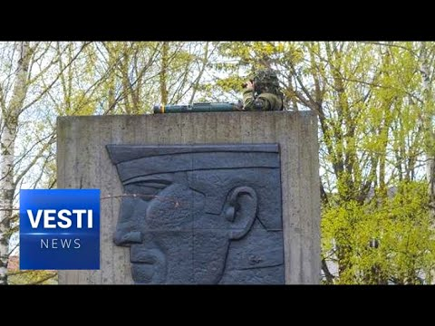 NATO Soldier With Grenade Launcher Taunts Russians, Climbs WWII Monument In Estonia!