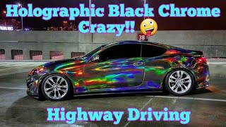 Holographic Black Chrome Car, holographic rainbow chrome vinyl wrap driving on the highway