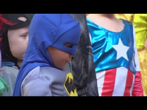 Kids with cancer shine at superhero fashion show