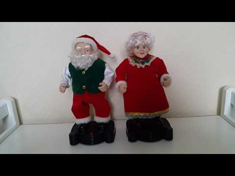 Singing and dancing Santa Claus with his wife