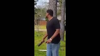 Black guy trying to break bottle on his head