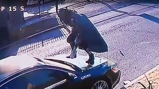 Woman Attacks Car For SIX HOURS (VIDEO)