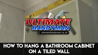 How to hang a bathroom cabinet on a tiled wall