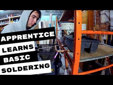 plumbing-apprentice-learns-basics-of-soldering-copper-pipe