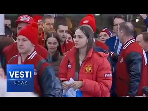 Welcome Home: Russian Athletes Return From Olympic Games to Patriotism and Praise