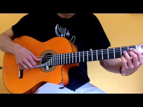 Flamenco guitar with a pick