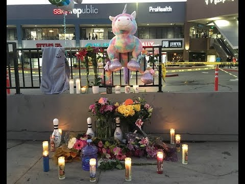 Rasual Butler and Leah LaBelle's devastated relatives hold vigil at scene of fatal car c rash