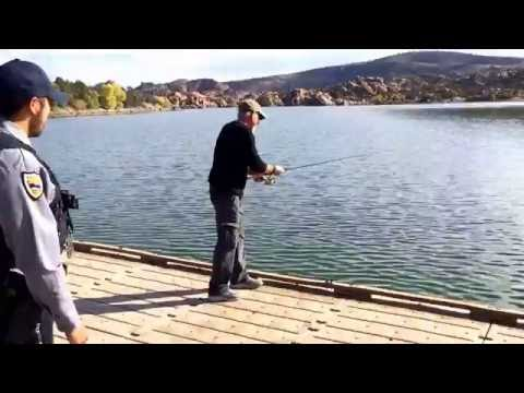 Arizona Game and Fish Department Wildlife Manager checks for fishing licenses