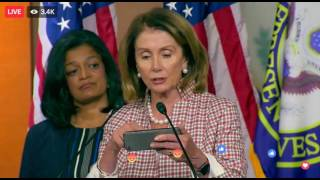 Pelosi reads off her phone during press conference