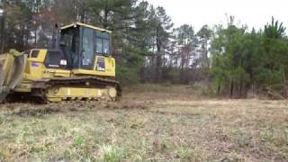 Bulldozer with Root Rake Clearing