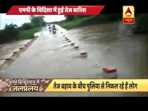 Rain havoc continues in various parts of the country, people endanger their life to cross