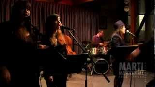 Jazz Chanteuse Marti Mendenhall scats her way through this tune, or...