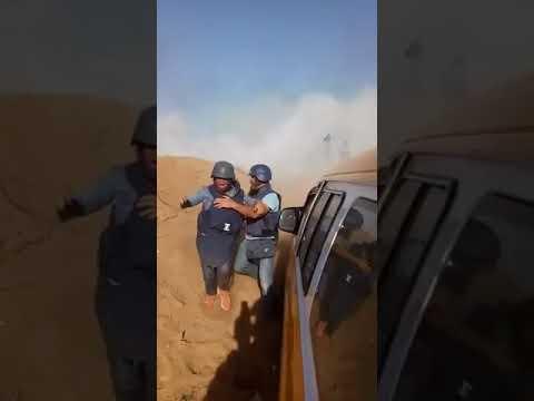 Israeli drone throwing tear gas at press workers in Palestine-Gaza