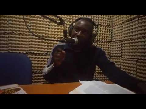 Pastor, Ronald Kogo, preaching on the radio in Nairobi, Kenya