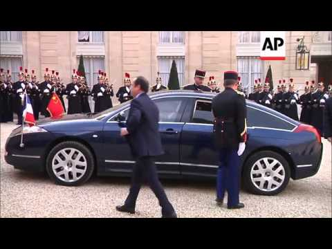 Chinese President Xi Jinping and President Francois Hollande hold talks
