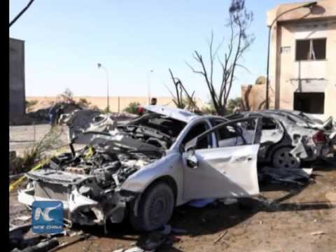Dozens killed in bomb attack at Libya's police center