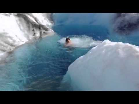 Tanalian Aviation Helicopter Pilots jumping into a glacier pool