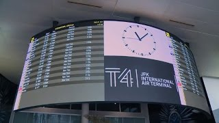 Travellers at New York JFK question electronics ban