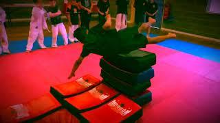 Martial arts training: Flying shoulder roll over strike shields