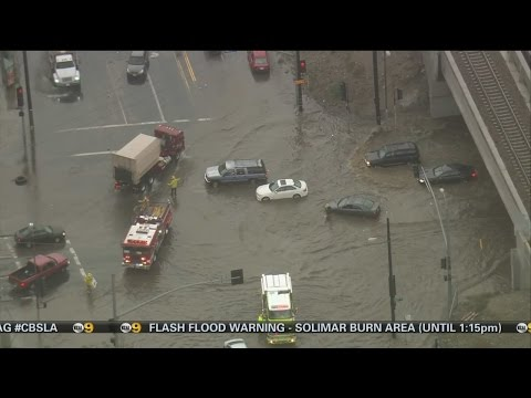 Cars Become Stuck In Flooded Sun Valley Intersection