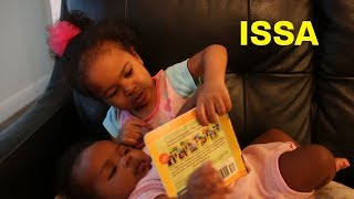 Toddler Reads To Baby Sister
