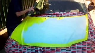 Painting Car With Brush and Roller