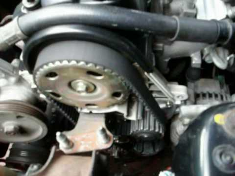 how to replace a timing belt and water pump part 2 2004 mazda 6 engine diagram 2004 Mazda 3 Engine Diagram