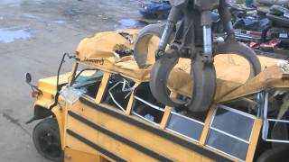 tearing apart a school bus