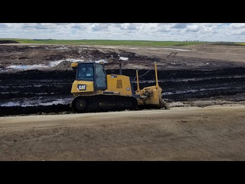 Heavy Equipment Operator Building A Highway.