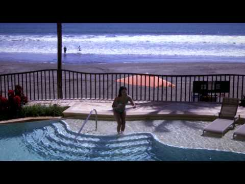 Slow motion Woman diving into a pool, stock video footage