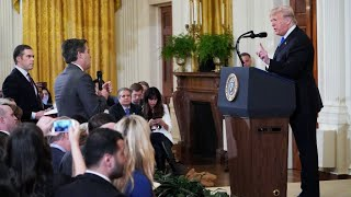 White House suspends CNN reporter's credentials after heated Trump exchange