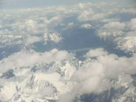 Los Angeles-to-Calgary flight descends over BC Rockies & Alberta foothills to land 2010-05-16