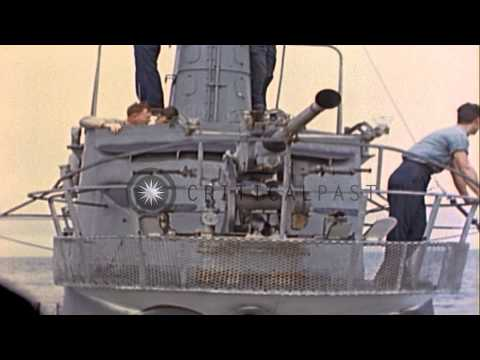 US submarine rescues Japanese crew from boat damaged by their gunfire during  Wor...HD Stock Footage