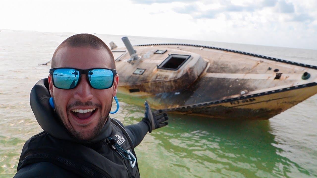 searching-sunken-abandoned-sailboat-in-ocean-inside-cabin